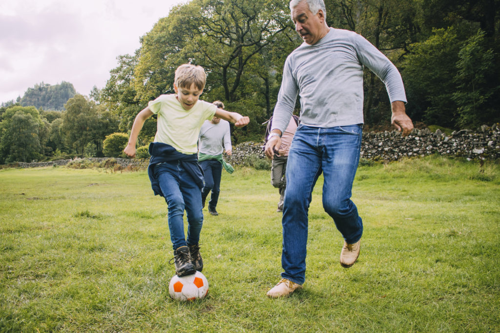 Tips To Reduce Your Risk of Cancer: Father and son playing football